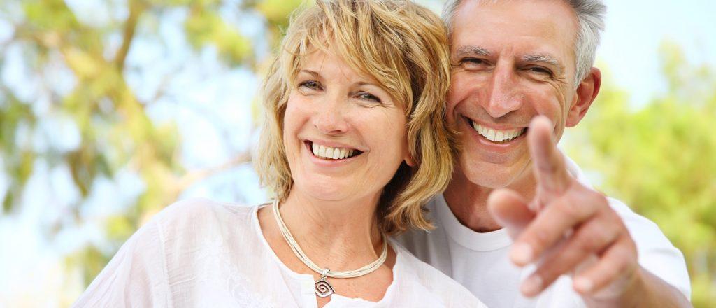 Close-up portrait of a mature couple smiling.